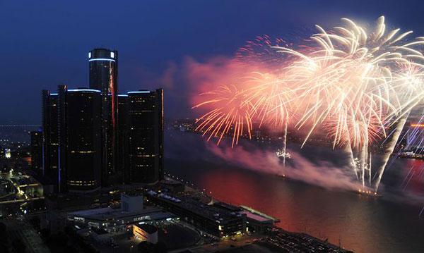 Fireworks going off over the Detroit River near the Ren Cen