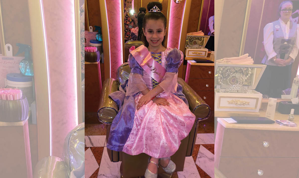 Kid dressed as a princess at a Disney Park
