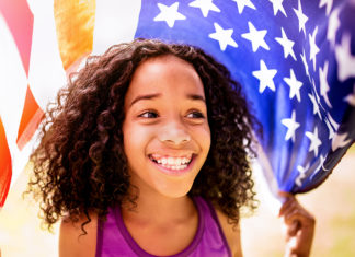 Young Black girl with an American flag