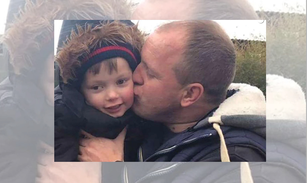 Lloyd Jones kissing his son Ollie on the cheek