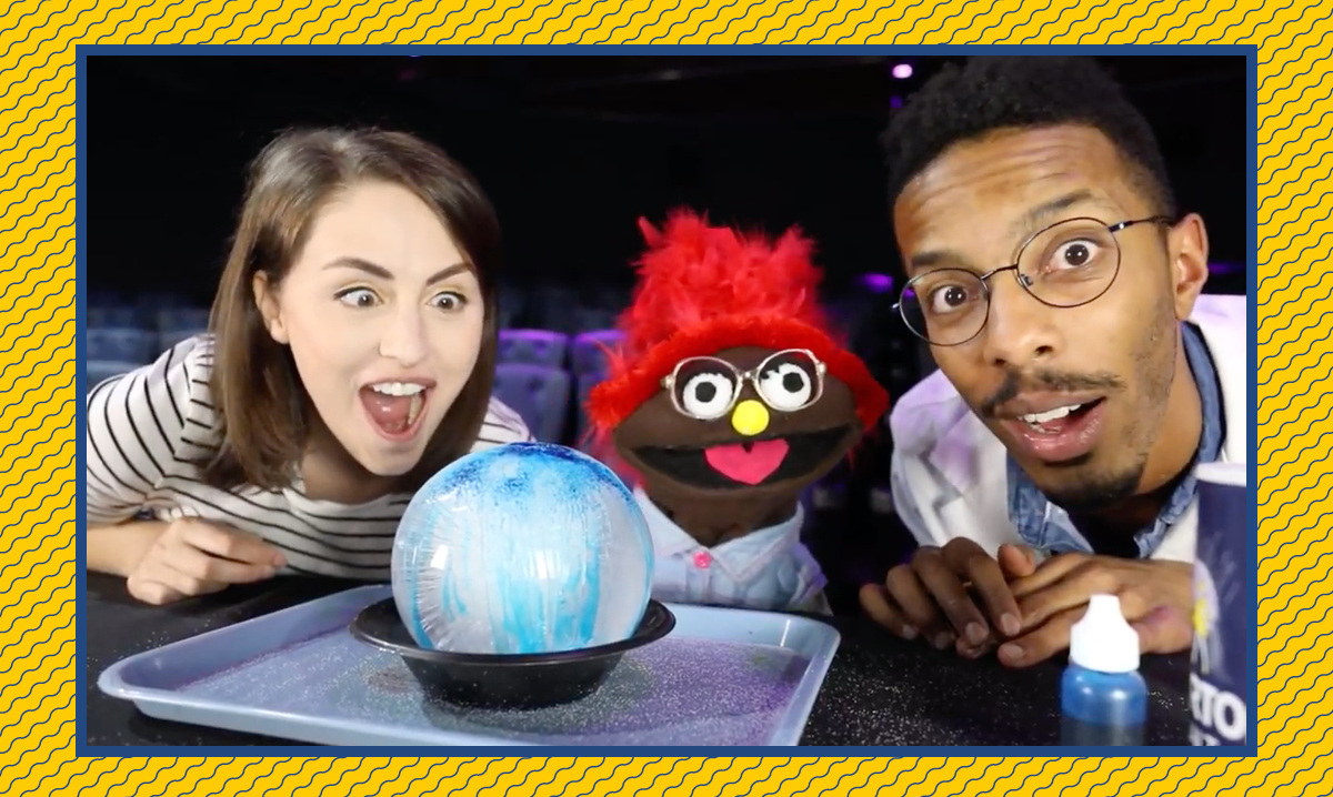 Taylor, Izzy and a scientist look excited about the icy balloon experiment
