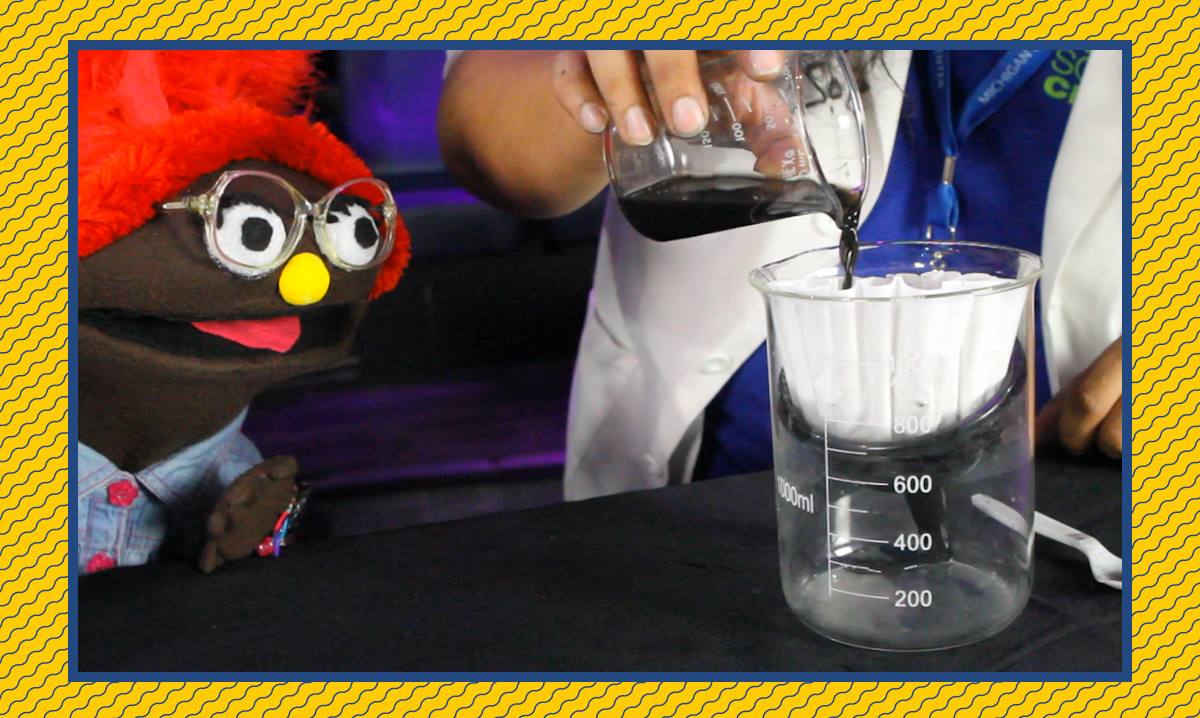 Izzy staring at a beaker