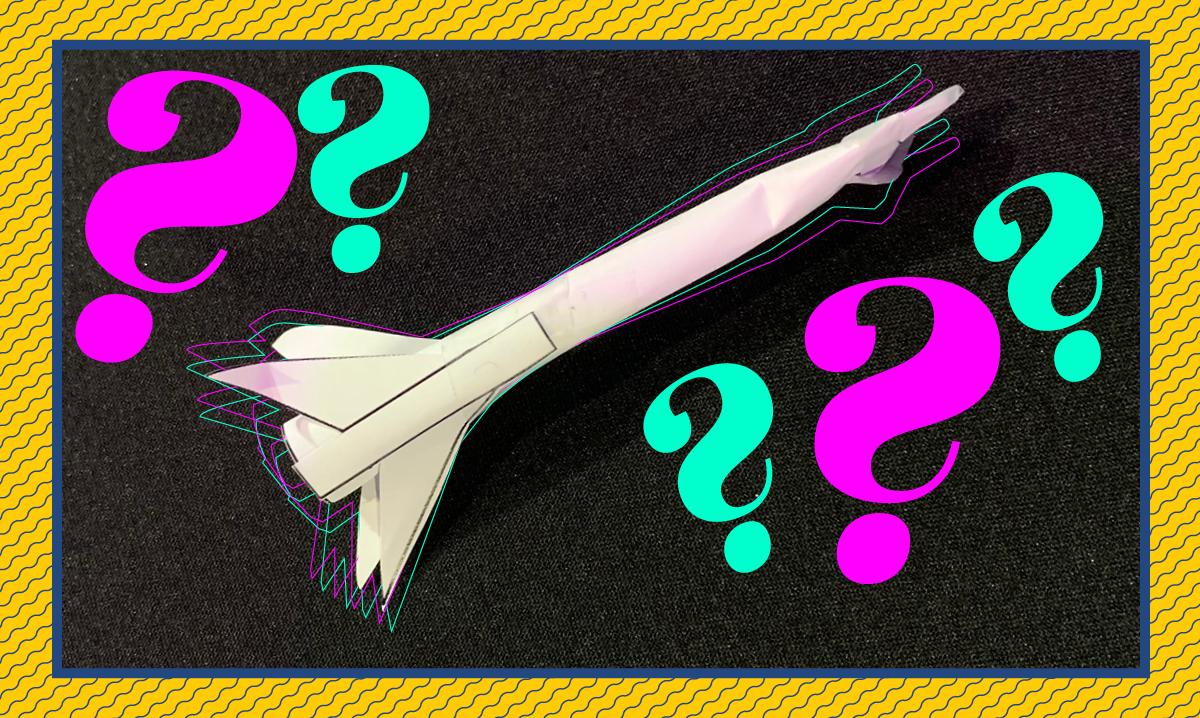 Straw rocket on a black background with a yellow border, featuring teal and pink question marks
