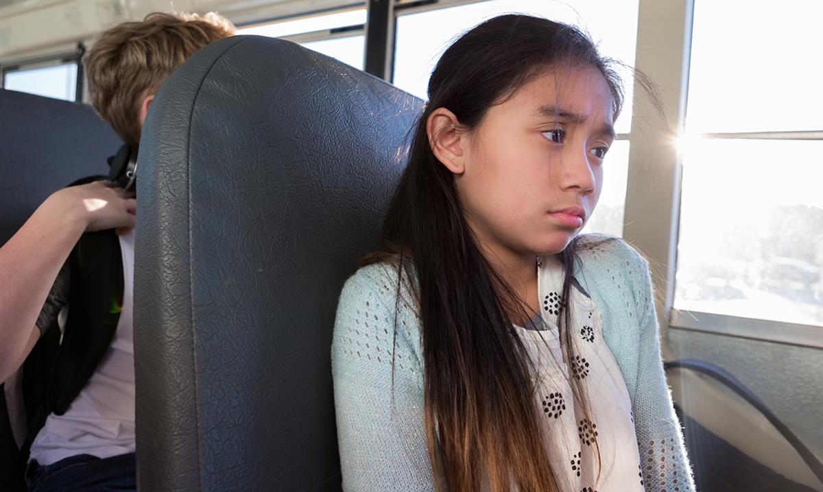 Sad girl on a bus