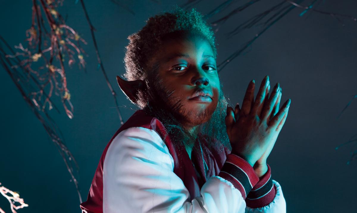 Boy dressed as werewolf on dark background