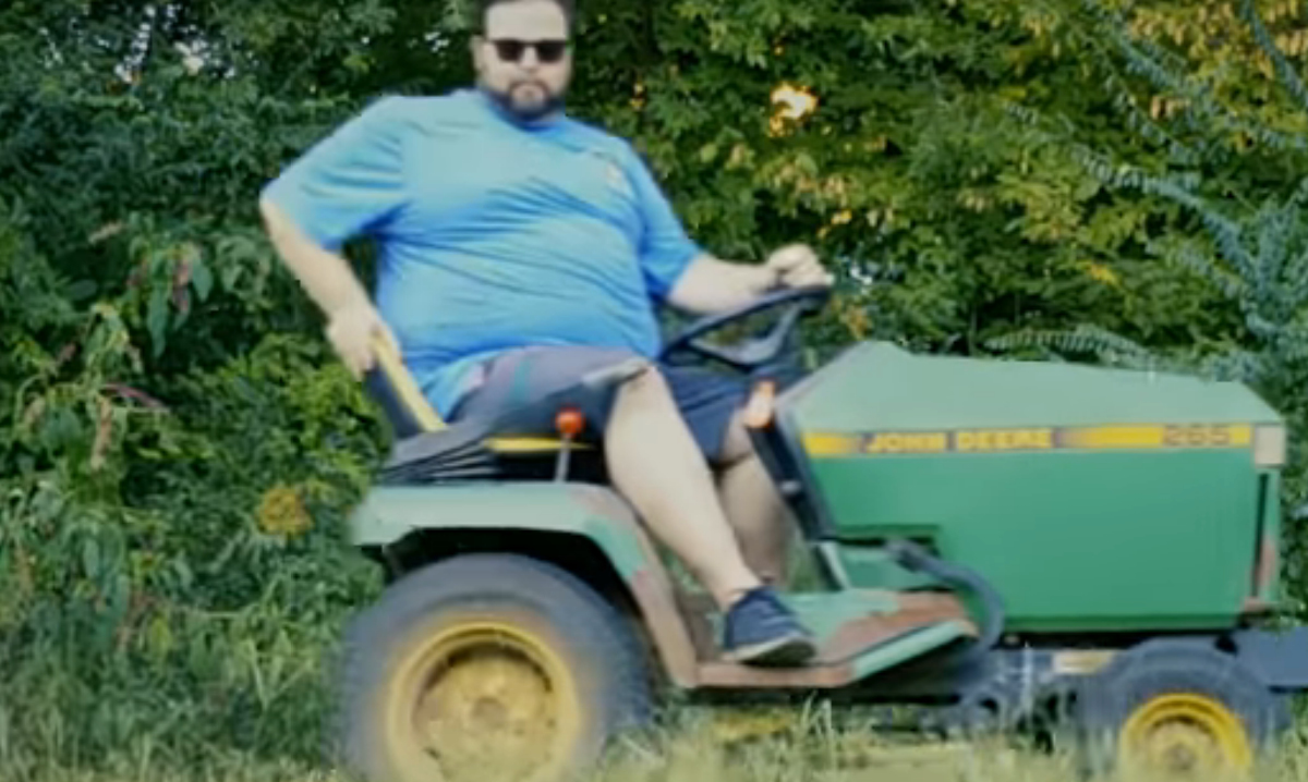 Connor riding a lawnmower