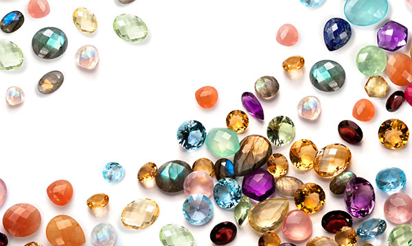 Different color gems on a white background
