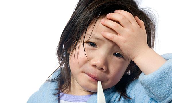 Little girl in blur robe holding her head