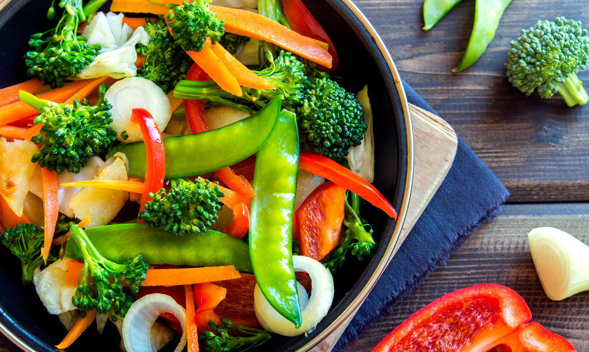Vegetable stir fry on a wood background