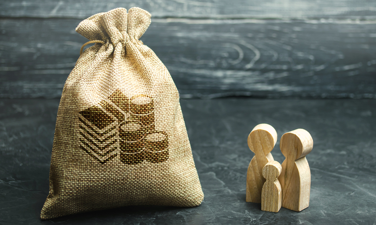 Big sack of money next to small wooden family of three