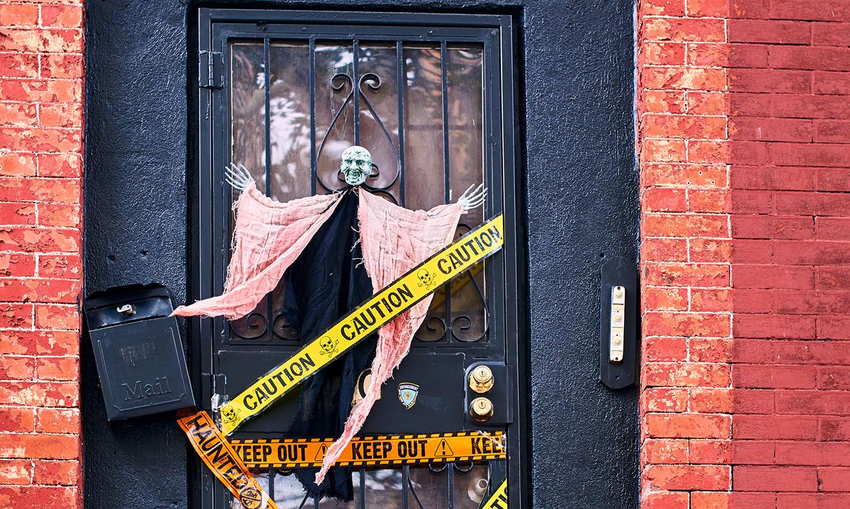 A black door decorated for Halloween