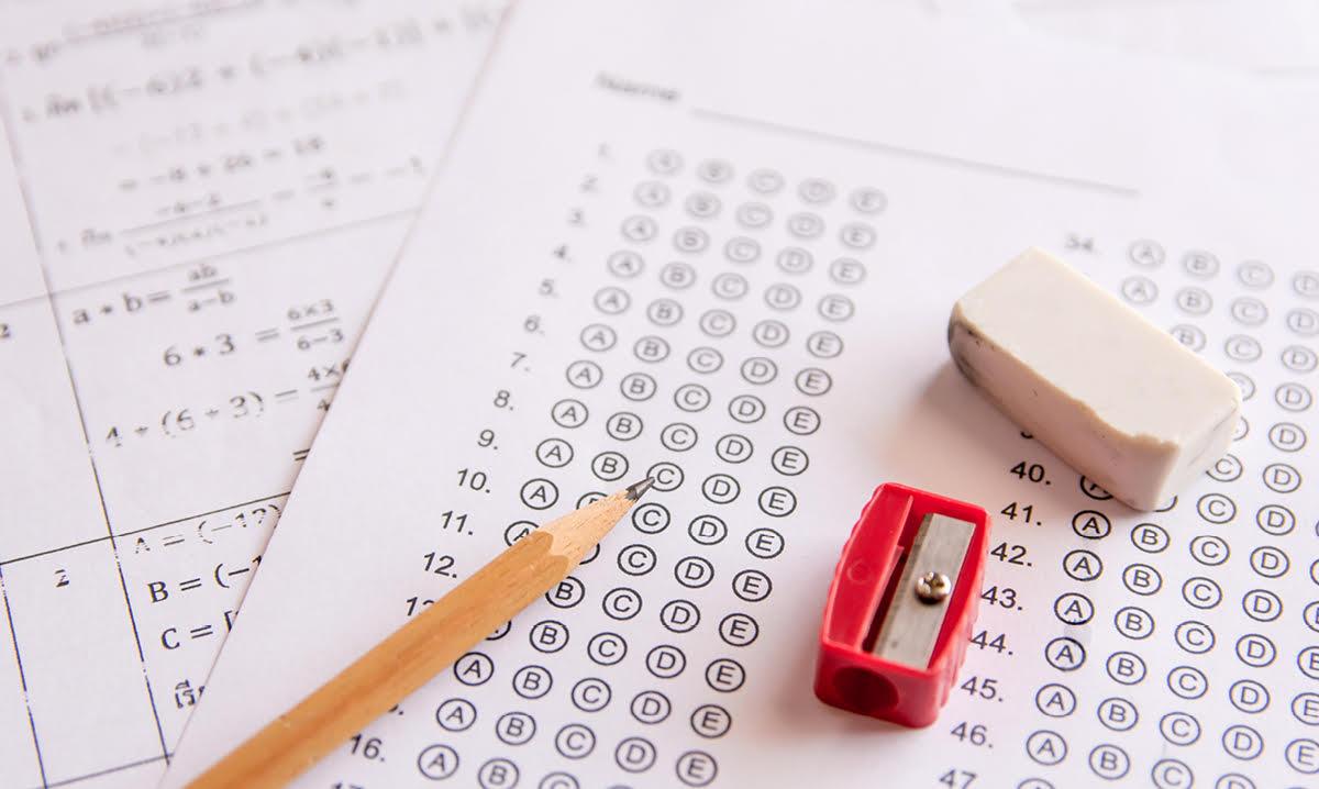 Pencil, eraser and pencil sharpener on test sheets