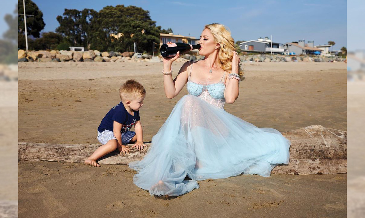 Heidi Montag drinking on the beach with her son