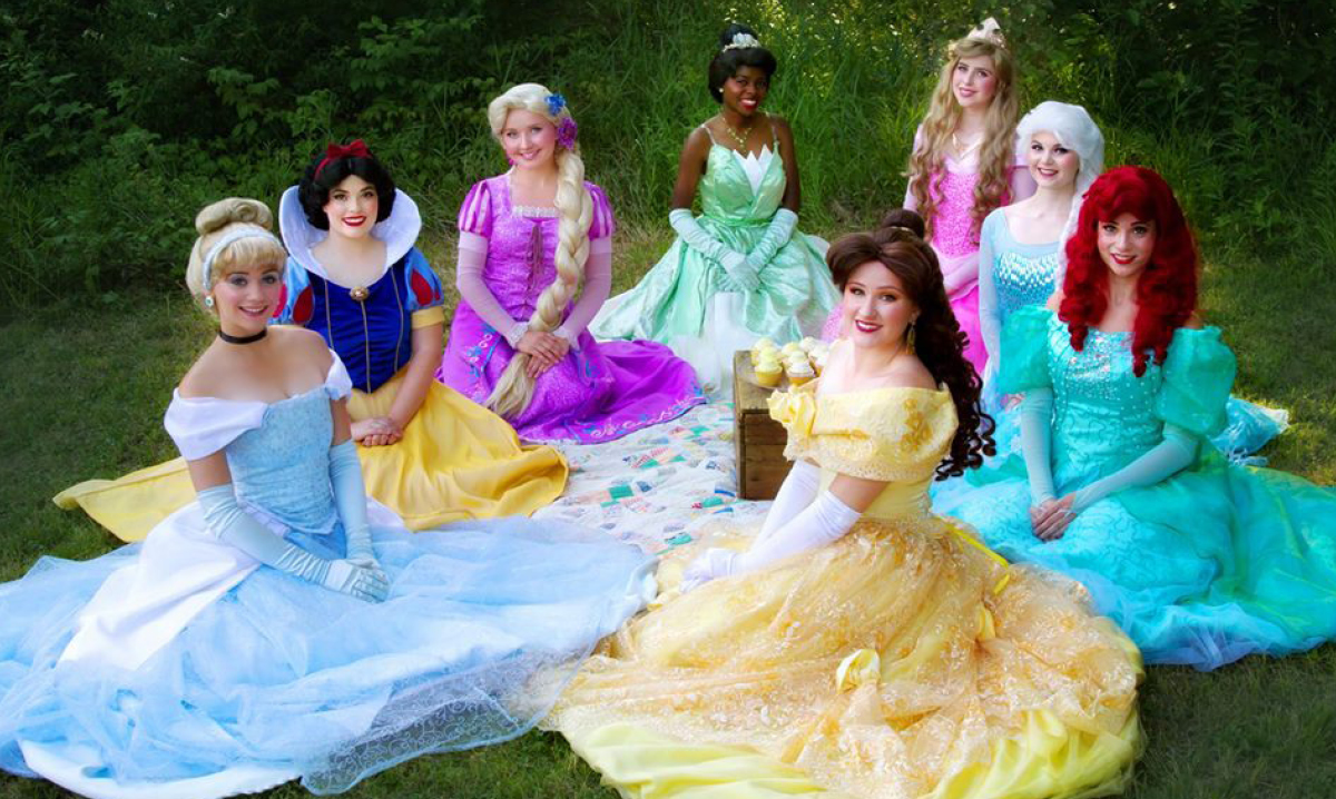 Disney princesses sitting on the ground