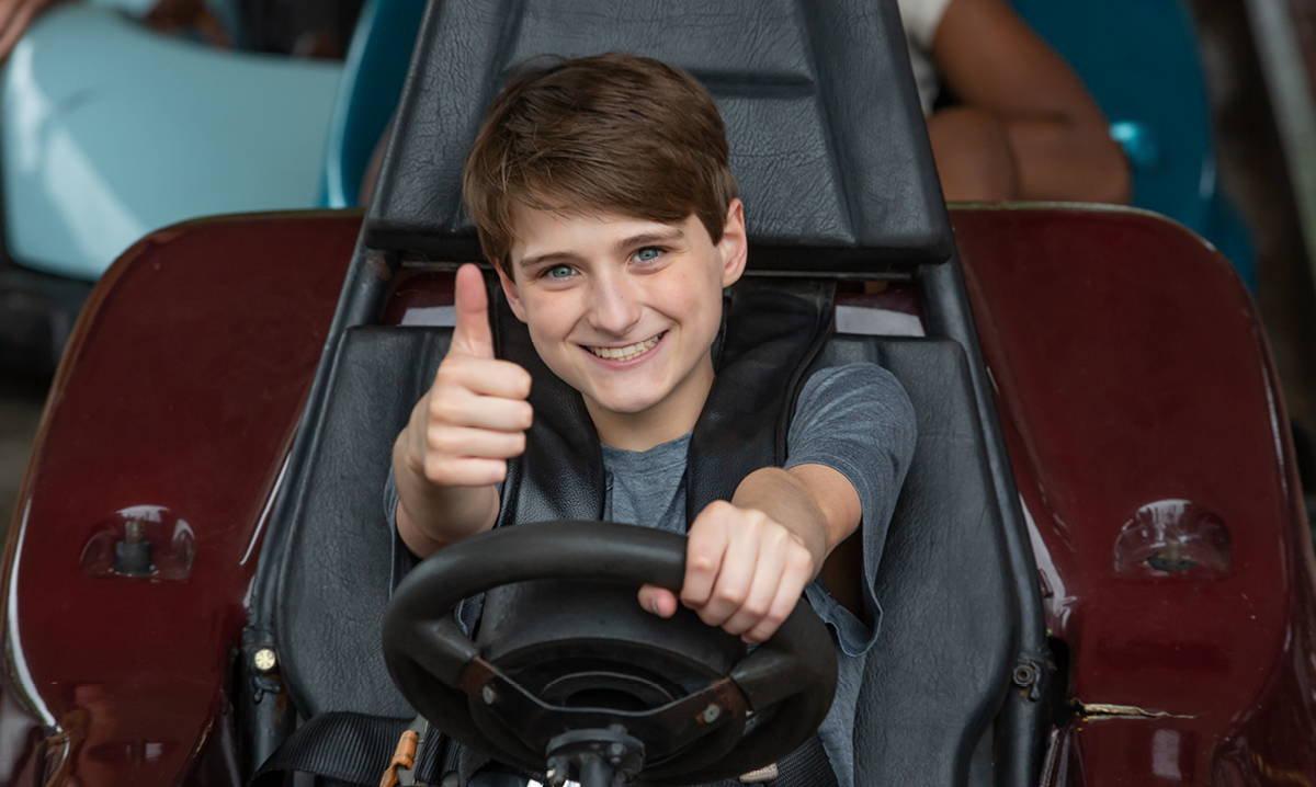 Young boy driving a go-kart at C.J. Barrymore's