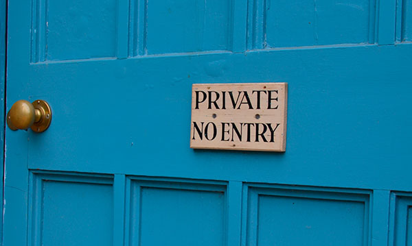 No entry sign on a blue door