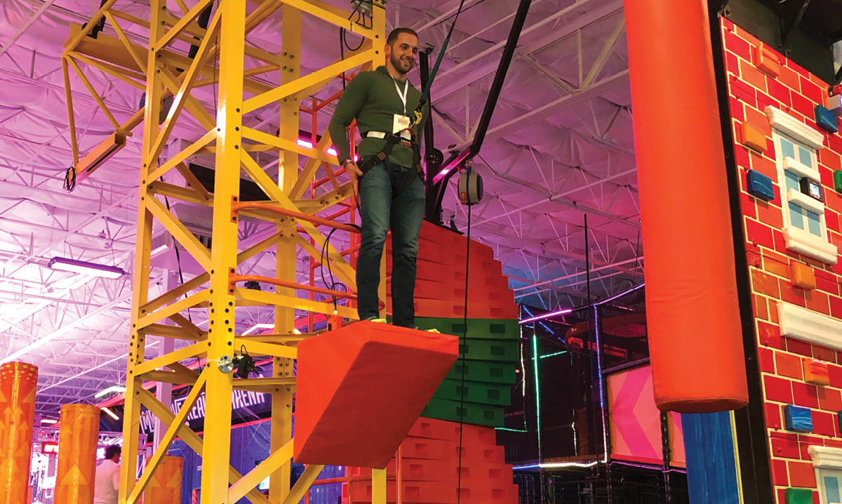 person on obstacle at urban air adventure park in sterling heights