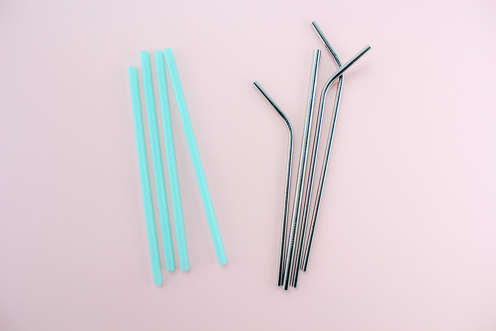 reusable straws on a pink background