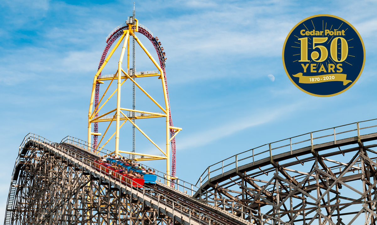 Gemini and Top Thrill Dragster at Cedar point with a blue sky backgroun, a circle says 150 years in the front
