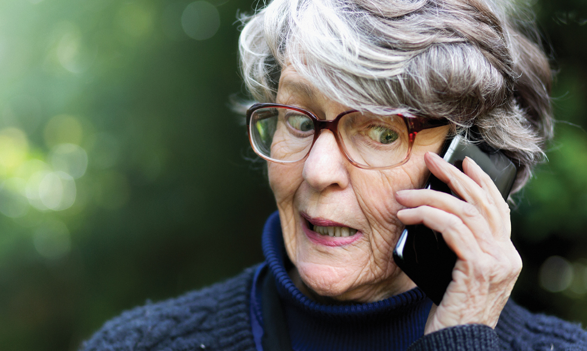 Elderly woman on the phone making a funny face