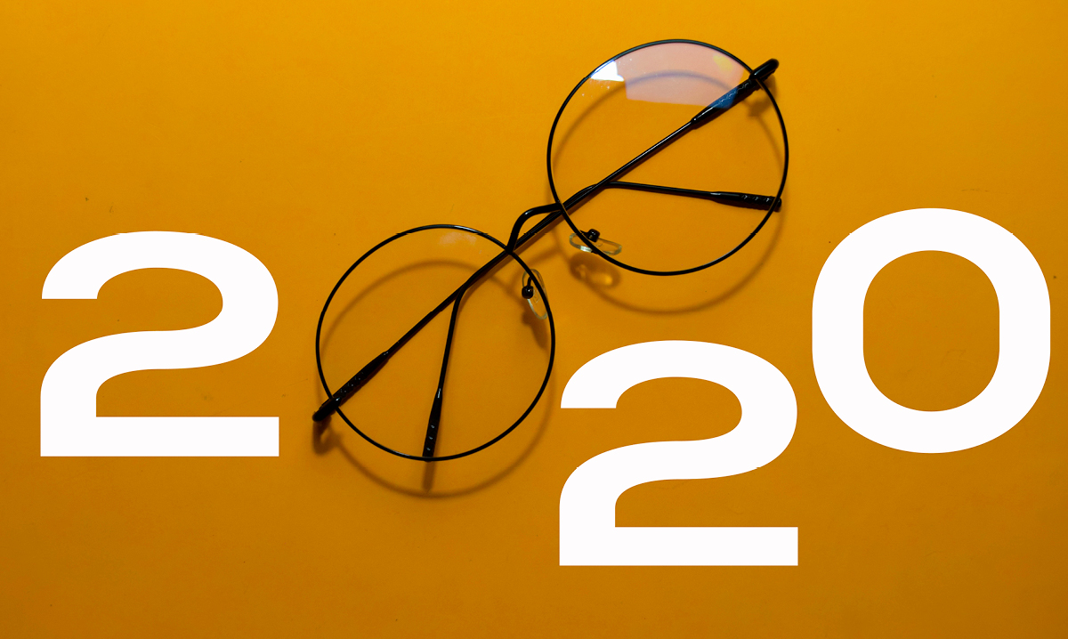 2020 with a pair of glasses on a yellow background