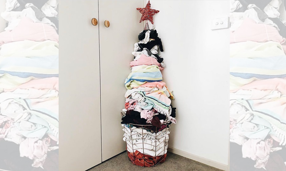 A Christmas tree made out of dirty laundry sitting in the corner