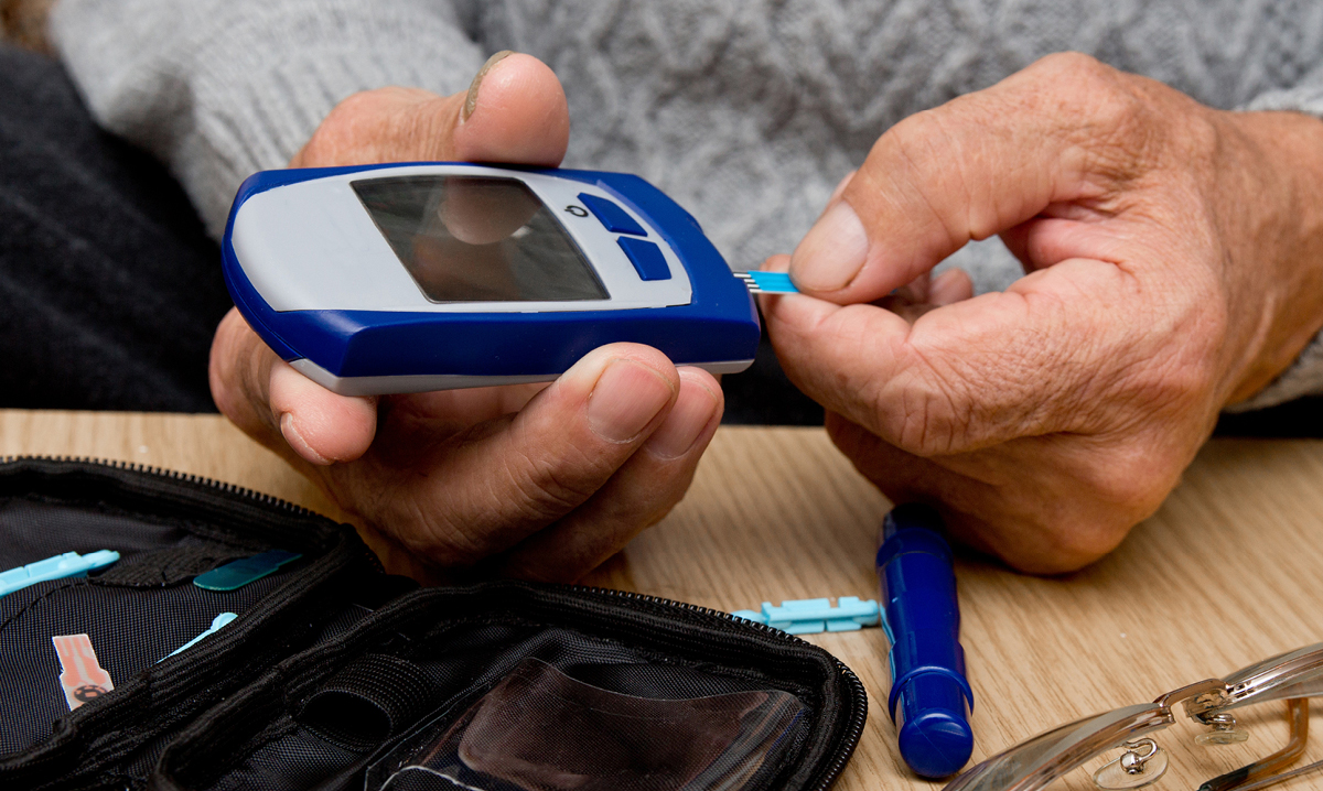 Person testing their blood sugar
