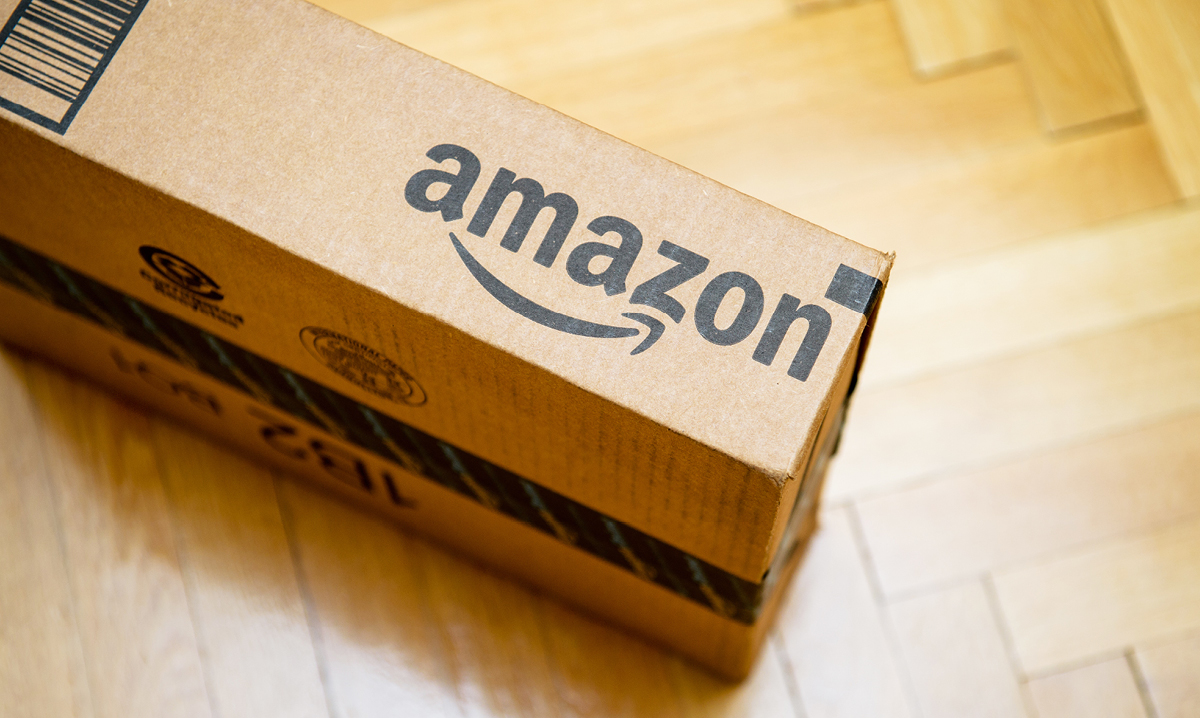 Close up of an Amazon package on a wood floor
