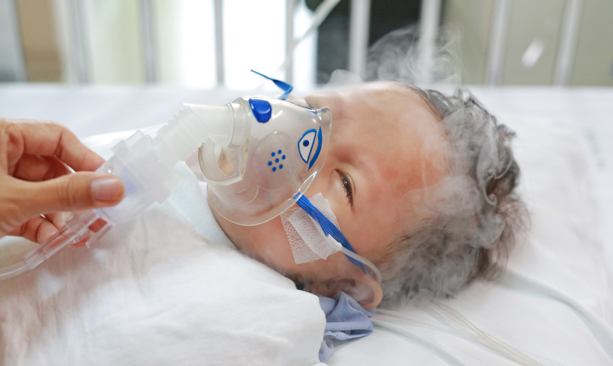 Baby with RSV gets a breathing treatment