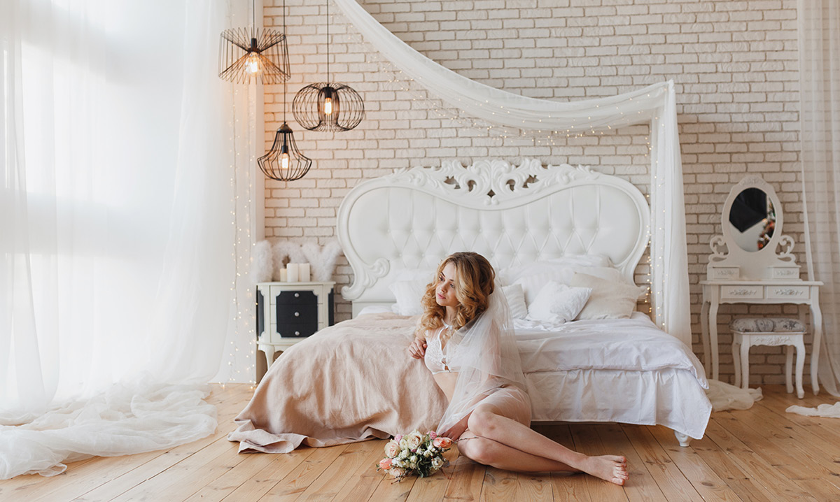 Woman poses for a boudoir photo