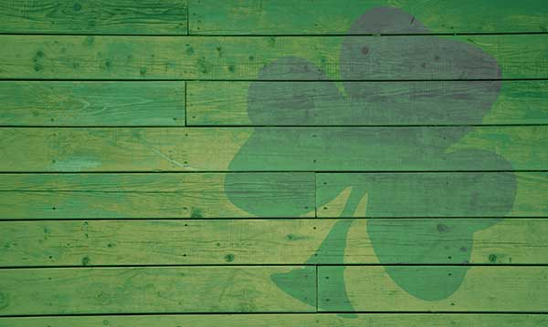 A shamrock painted on green wood planks