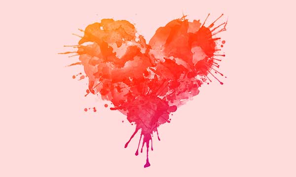 A painted heart on a pink background