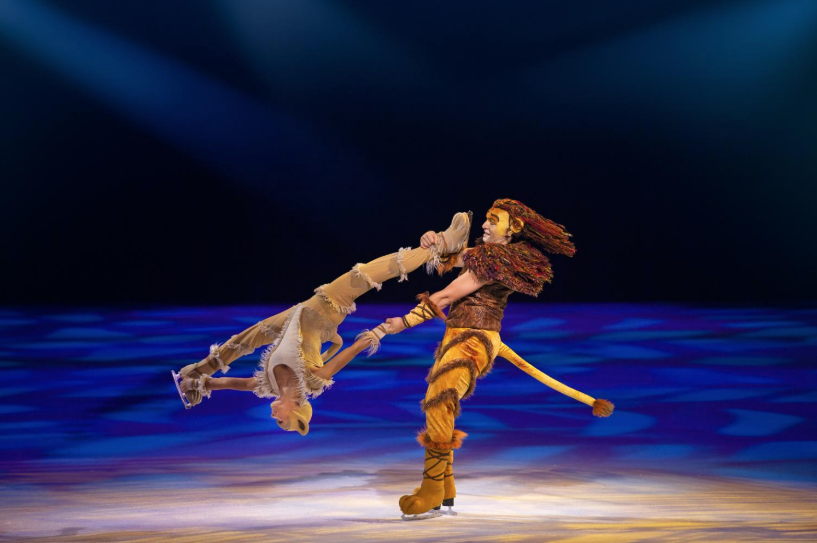 Two ice skaters dressed as lions