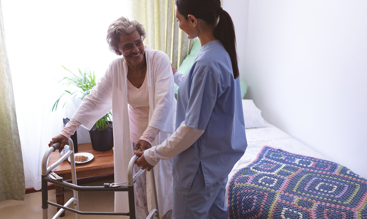 Nurse helping an elderly woman
