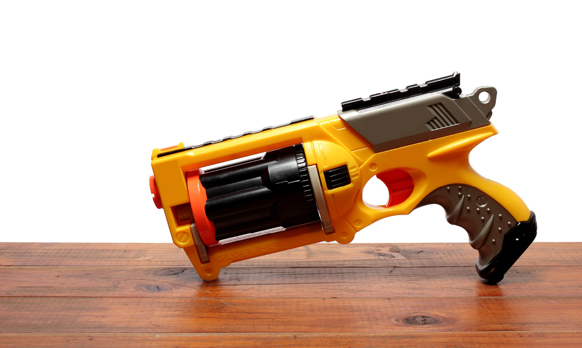 Nerf gun sitting on a wood table