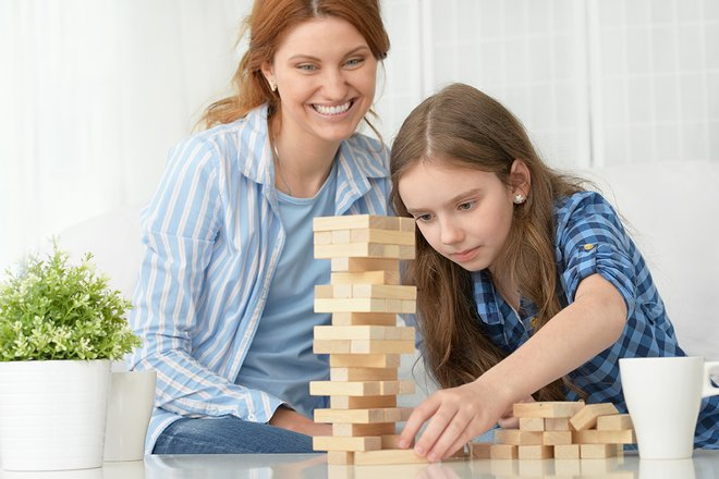 Woman and girl playing Jenga