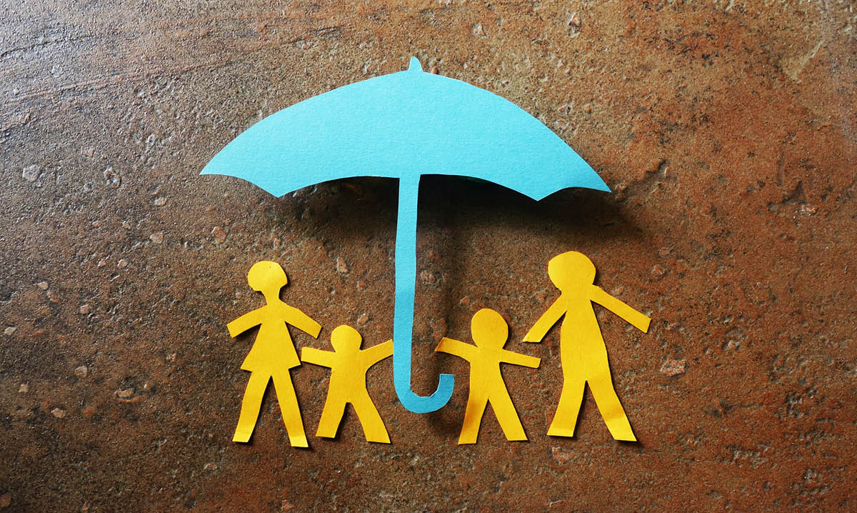 Paper family under an umbrella