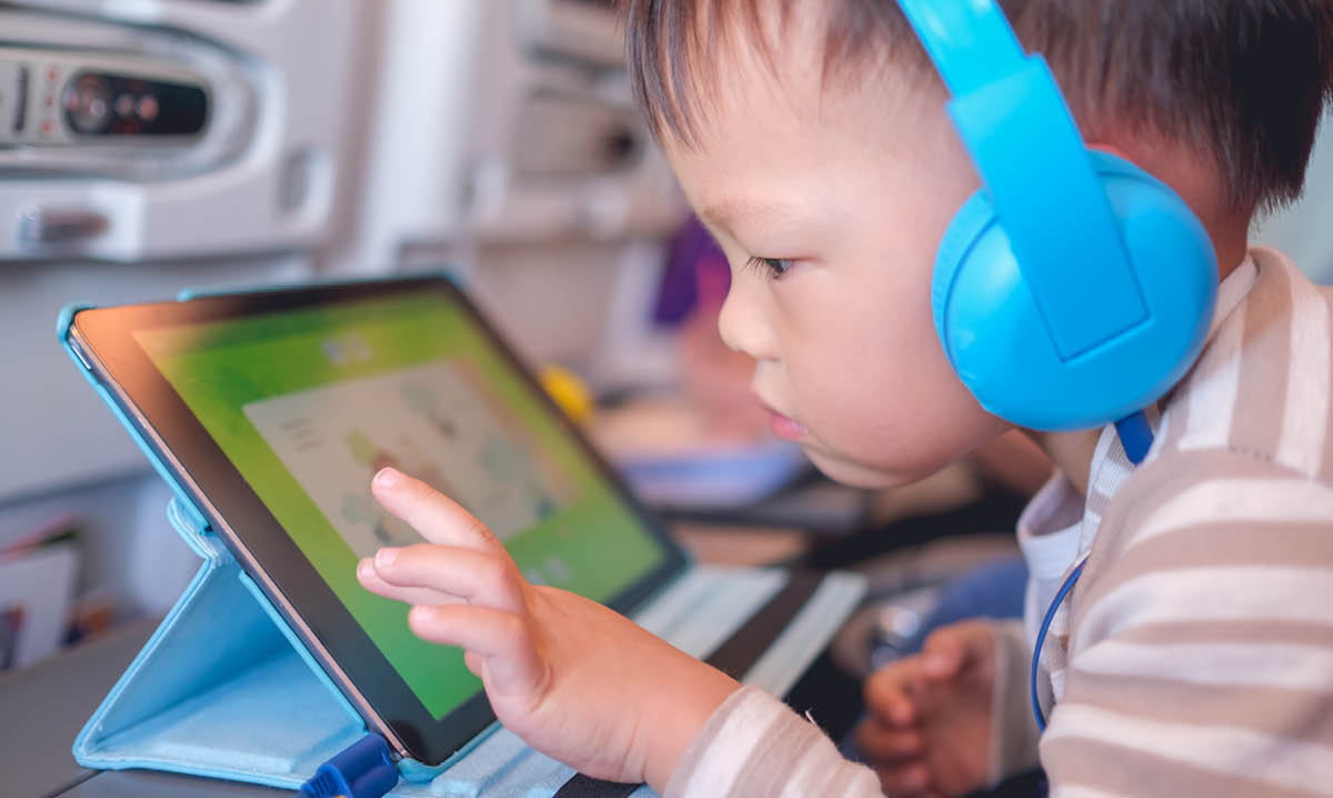 Little boy playing on a tablet