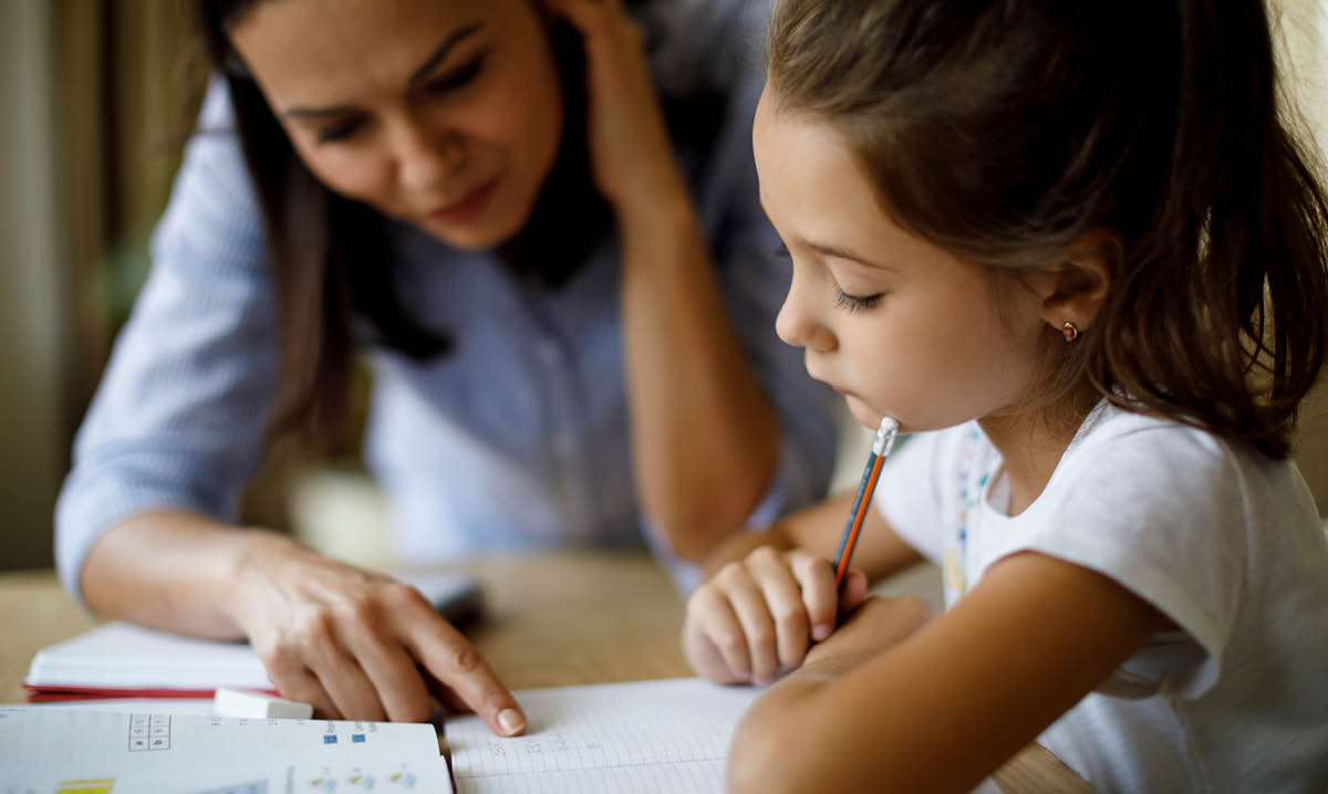 Woman helping a child with homework