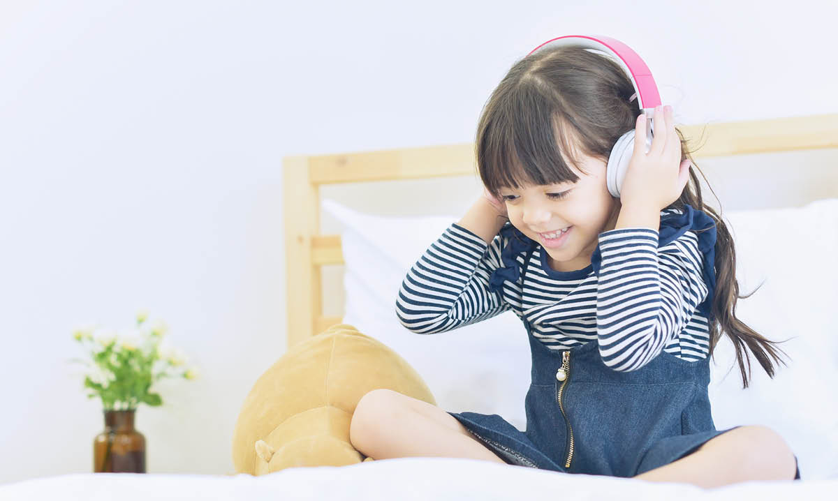 Girl smiling while listening to headphones