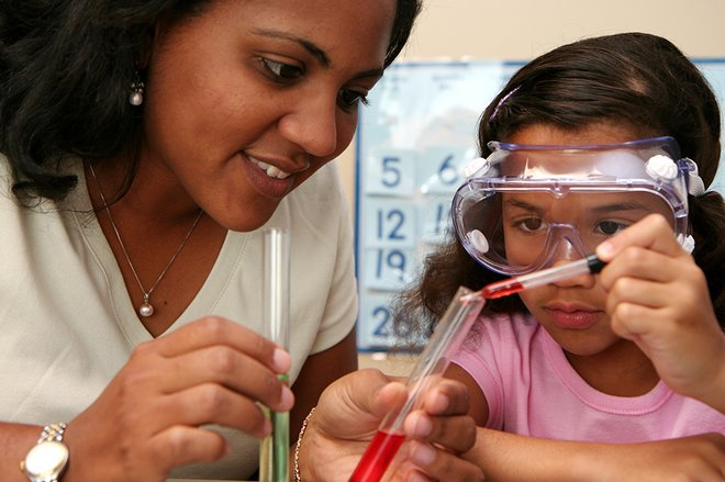 Woman and girl doing science experiments