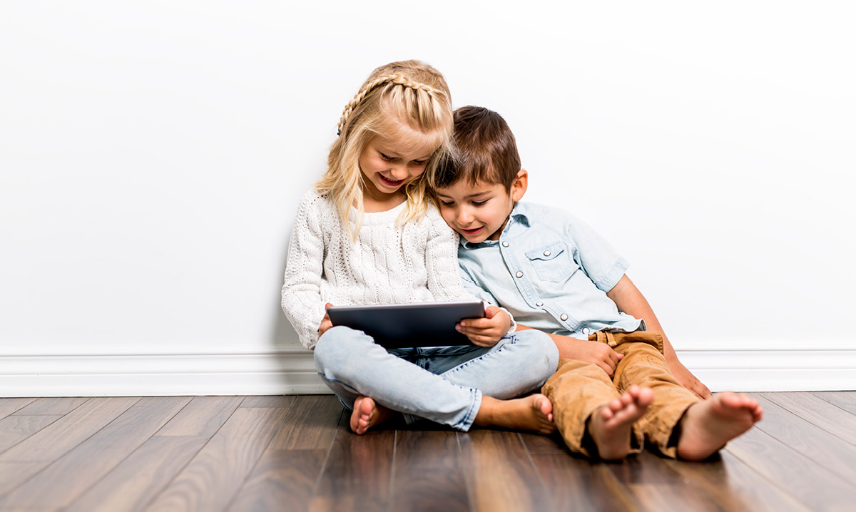 Two kids playing on tablet