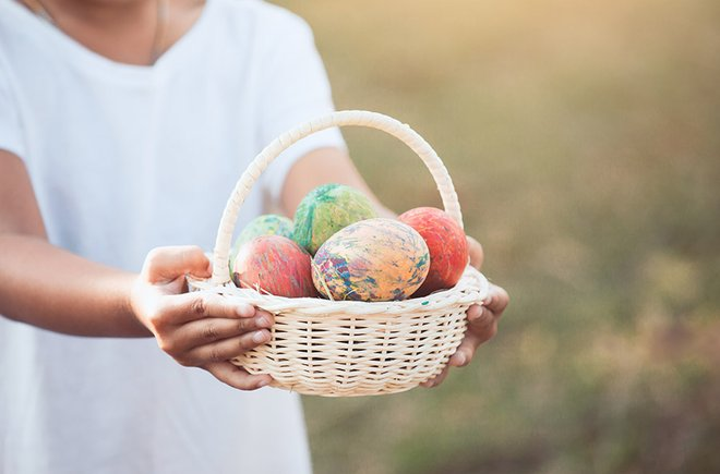 Woman holding a basket of Easter eggs