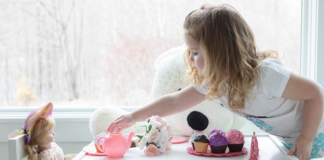 Child having a tea party