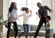 Family dancing in the living room