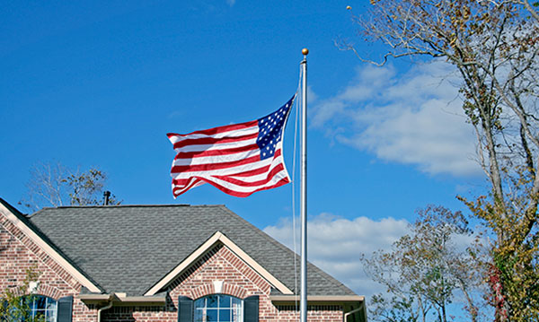An American flag flying above a building