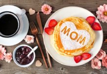 Pancake brunch with the word mom written in a pancake