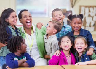 Kids hugging their teacher