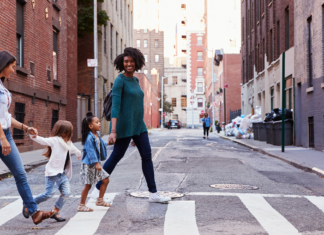 Family of four walking down a city street