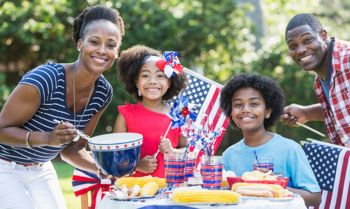Family of four celebrating Memorial Day at home